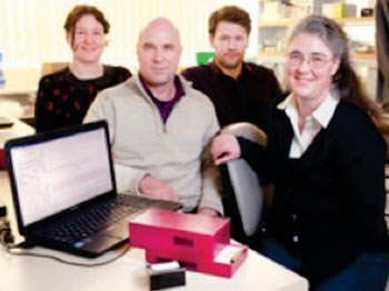 Image: The Freedom4 PCR unit for field use was developed by (L-R) Ms. Christy Rand, Mr. Chris Mason, Dr. Chris Rawle, and Dr. Jo-Ann Stanton (Photo courtesy of the University of Otago).