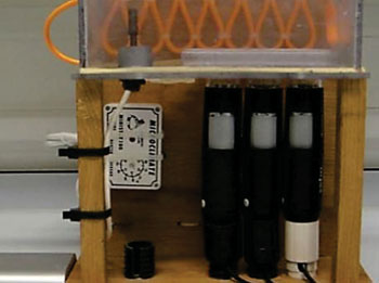 Image: The low cost microscope system constructed to perform multiple simultaneous time-lapse studies on various cell types (Photo courtesy of Adam Lynch).