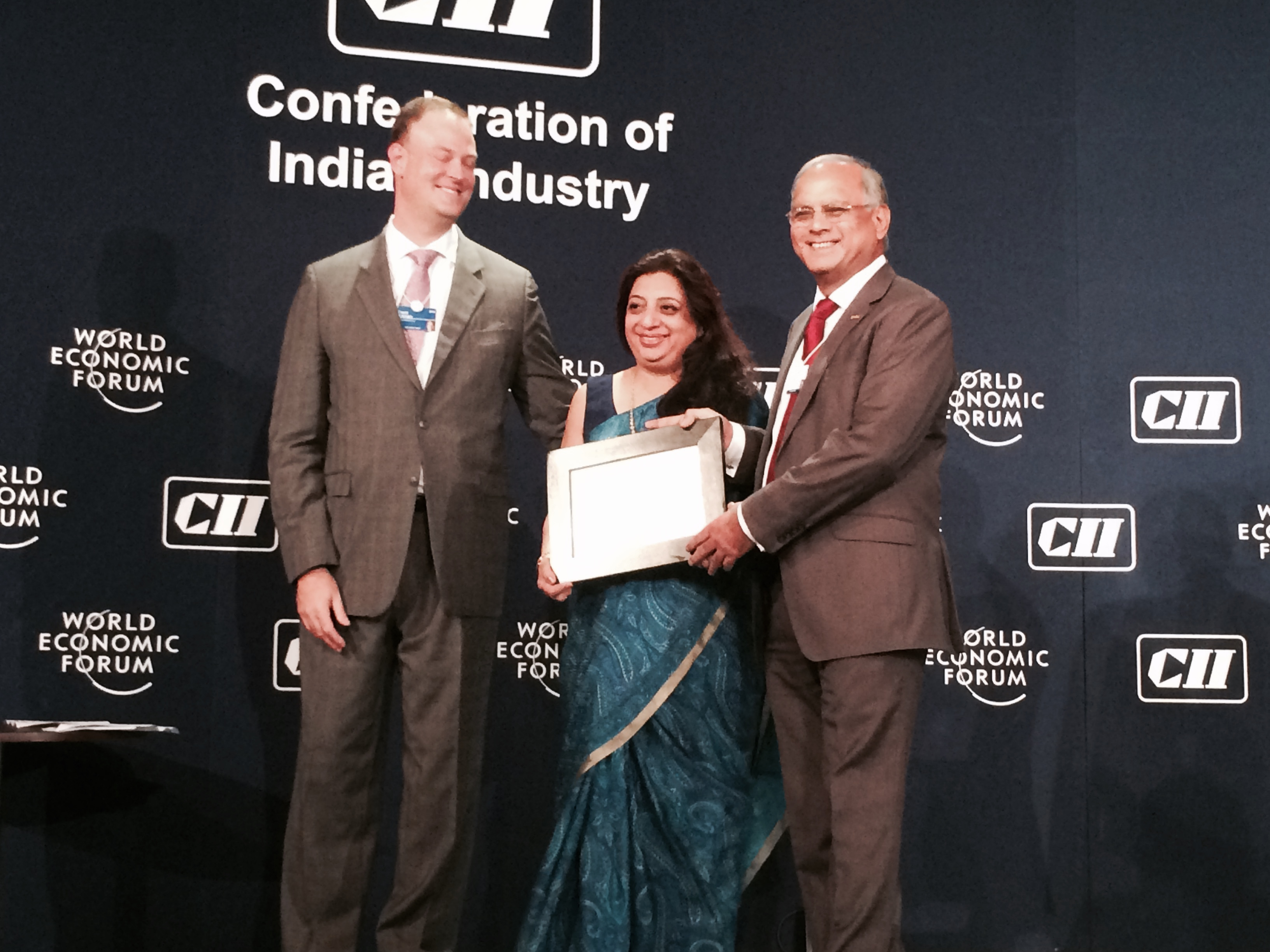 "Image:  Transasia Bio-Medicals's Mr. Suresh Vazirani, CMD, and Ms. Mala Vazirani, Executive Director, receives the ""Global Growth Company-2014"" award from Mr. David Aikam, Managing Director, Head of New Champions, World Economic Forum (Photo courtesy of Transasia Bio-Medicals Ltd.)."