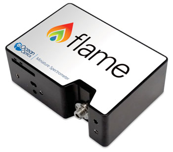 Image:  The Flame – a miniature spectrometer for medical diagnostics, biotechnology, and life sciences, that brings flexible optical sensing power to laboratory and point-of-care instrument integration (Photo courtesy of Ocean Optics).